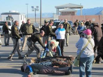 Arrests at the gates of Creech AFB as protesters hold a die-in (Margeaux Süreyya Temeltaş)