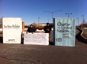 Protesters blockade Hancock AFB using giant copies of drone reports, UN Charter and US Constitution